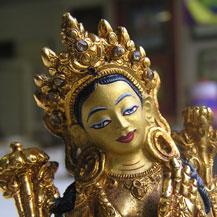 Het Boeddhabeeldje van Groene Tara na de restauratie en schildering - ze is nu weer als nieuw
