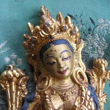 Groene Tara beeldje dat schade had opgelopen door een brand